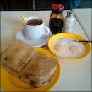 Kaya toast, half-boiled eggs, kopi C kosong.