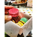 Gingerly digging into the @MaisonLaduree #macarons of love.