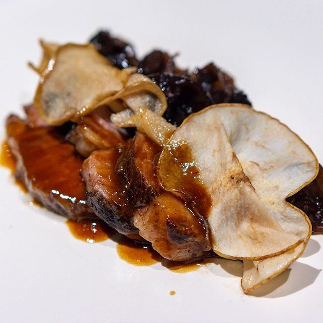 Signature Beef Short Rib, sous-vide till deliciously fork-tender, with crunchy and charred black fungus, black garlic-potato puree, Chinese pears and finished with a drizzle of luscious sauce made from roasted chicken stock and caramelised onions, infused with Angelica root for a slight bitterness.