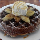 Waffles with banana , vanilla bean ice cream and home made salted caramel sauce..