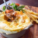 Get cosy with this Beef and Ale Pie ($19) in the sudden downpour.
