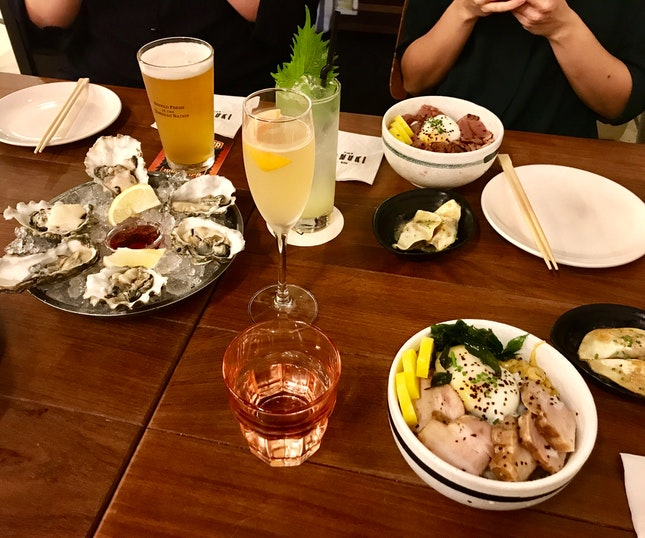 Assortment Of Donburis And Happy Hour Cocktails And Oysters