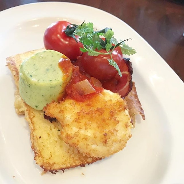 Boulevard St Michel: savoury french toast with double baked cheese and spinach soufflé, parmesean crumbed poached egg, slowroasted tomatoes, grilled back bacon and spicy tomato chutney.