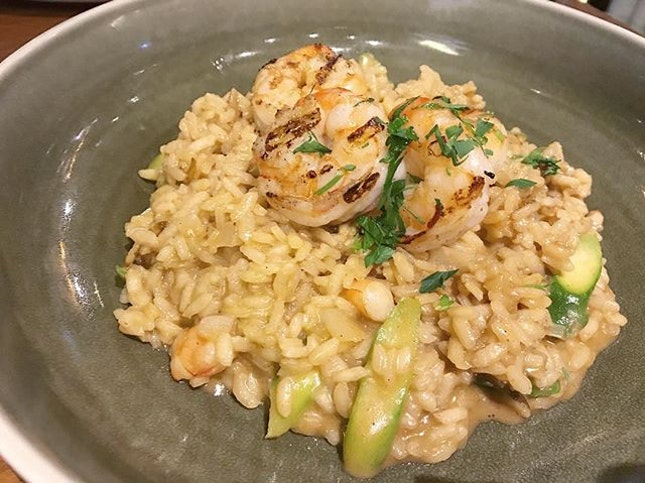 Garlic Prawn Risotto - Chargrilled garlic prawns with arborio rice and asparagus in prawn bisque.