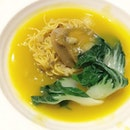 Braised Crispy Noodle with Whole 8-head Abalone in Pumpkin Sauce .