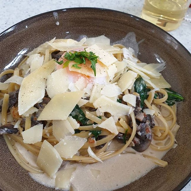 Truffle Mushroom Pasta with sous vide egg and shavings of parmigiano.