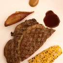 Grilled Smoked Japanese Wagyu from Omi served with grilled corn and red onion. ($190++ per serving).