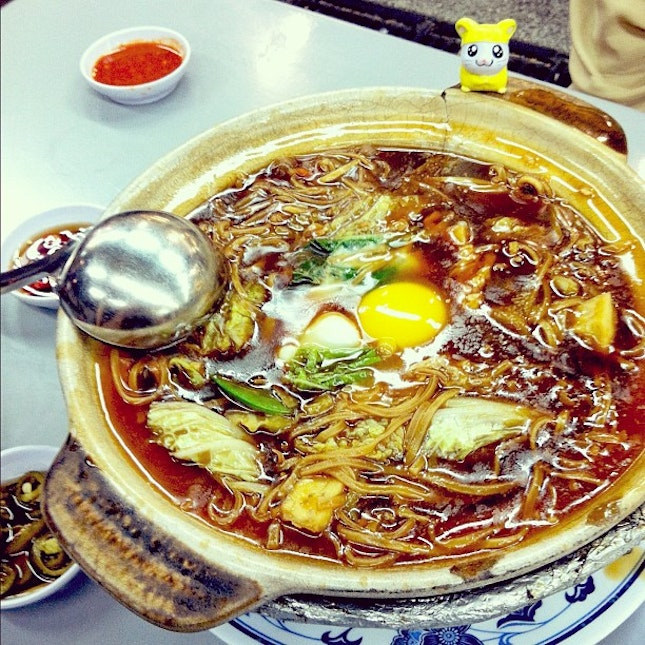 Chinese noodles topped with an egg (and Penelope!).
