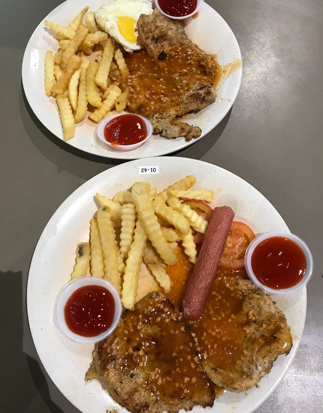 Pork chops with fries and baked beans ($6.50), extra egg/sausage (+ $0.50)
