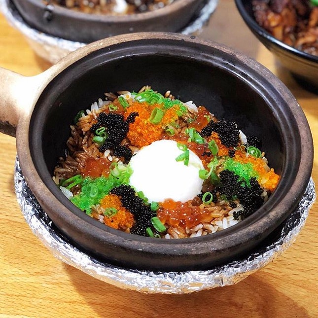 @house_of_happiness_sg offers claypot rice with a twist like the Onsen Egg with Ikura & Tobiko Claypot ($11).