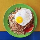 "Smokily aromatic ""nasi goreng putih mata lembu"" also known as the white version of fried rice with crispy anchovies, topped with a bullseye egg."