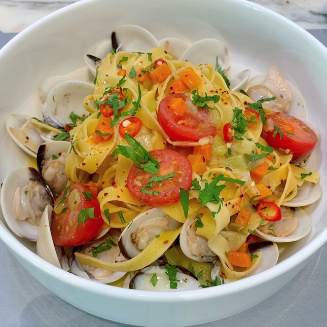 Fresh Tagliatelle with Clams, Chilli and Parsley ($28++)