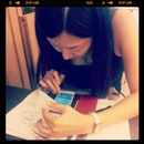 Wife busy with some calculation stuff at Wang Cafe...