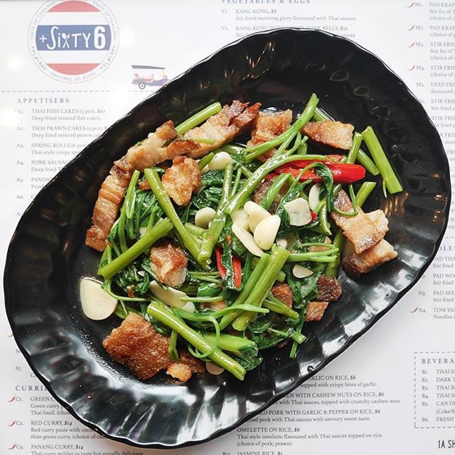 Kang Kong with Crispy Pork Belly •SGD 12 NETT•  Stir fried morning glory with Thai sauces, chilli and garlic, topped with crispy pork belly - a dish that is not commonly seen anywhere.