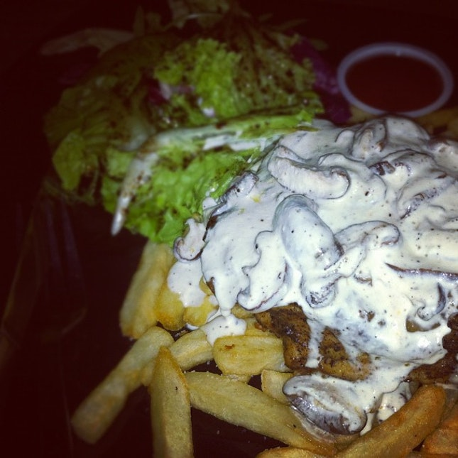 Grilled Chicken with Creamy Mushroom Sauce served along with 2 sides, Fries and Salad!