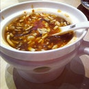 Sichuan spicy and sour soup that came in this really cute hot-pot like serving.