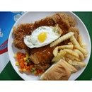 Ye Lai Xiang Tasty BBQ Huge Crispy Chicken Cutlet topped with bread & fresh fries.