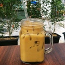 Quenching our thirst with a Thai Iced Milk Coffee that failed to satisfy with its diluted taste.