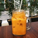 Quenching our thirst with an Iced Thai Milk Tea that fared better than the coffee in terms of taste!