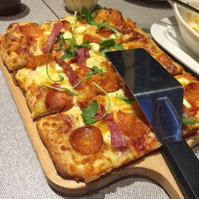 Signature Pizza - Savory chicken pepperoni topped with turkey bacon with a mixture of different cheese and cheddar.