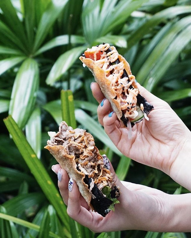 hats off to the one who came up with gyocos, which are essentially tacos made of fried gyoza skin, stuffed with sushi rice and either wasabi butter beef or tuna sashimi, and topped with mentaiko sauce!