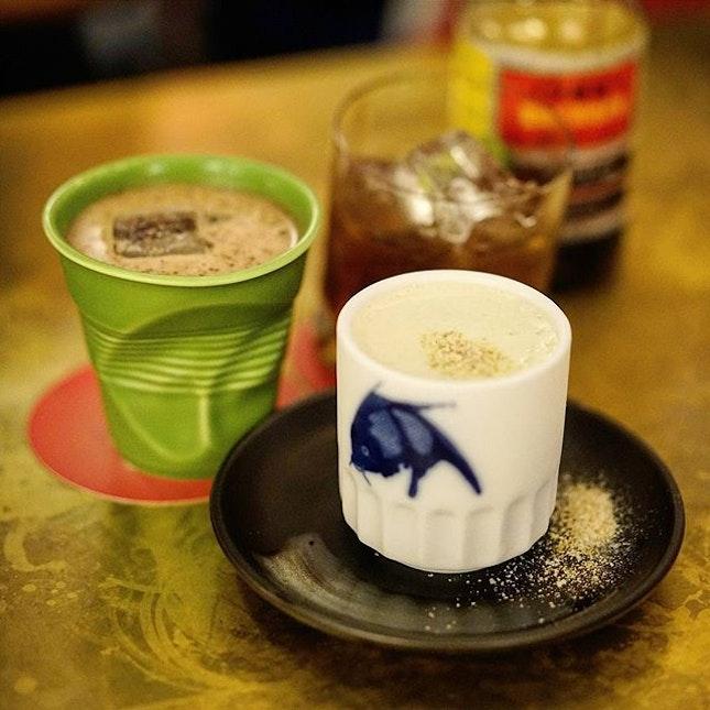 Roti Kaya— a cocktail of whisky, aged rum, gula melaka, pandan, coconut cream and egg yolk.