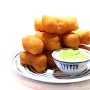 Par Thung Go hot fried fluffy dough sticks with cold creamy pandan coconut custard.