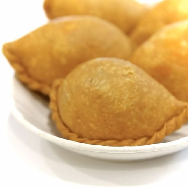 The humble Curry Puff is awarded the Michelin Bib Gourmand.