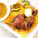 The signature Nasi Briyani (or briyani rice) made with fluffy, long-grained high-quality basmati rice.