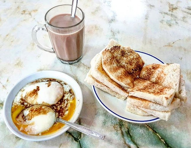 kaya toast w/ butter, soft-boiled eggs & hot milo  14.5.19 #foodporn #sgfoodporn #foodsg #sgfoodies #instafood #foodstagram #vscofood #burpple #hungrygowhere #hawkerfood #hawkercentre