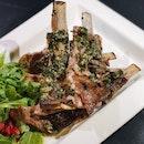 Josper-Grilled Lamb Ribs with Frisee Salad & Pomegranate ($38++)
