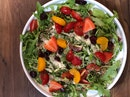 Arugula & parmesan balsamico salad with cherry tomatoes, oranges and pomegranate