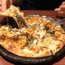 [Mentaiko Mochi Pizza] [$16.80] Thin crust pizza that is topped with cheese, squid, prawns and of course, mochi 😄  Loved the crisp base of the pizza paired with the chewy mochi and squid toppings.