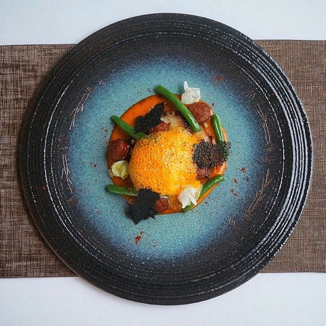 Octopus & Chorizo, topped with a 63 degrees egg and squid ink crisps.