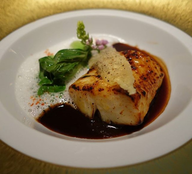 Caramelized black cod with bok choy and a Malabar black pepper sauce at Singapore's Joel Robuchon Restaurant .