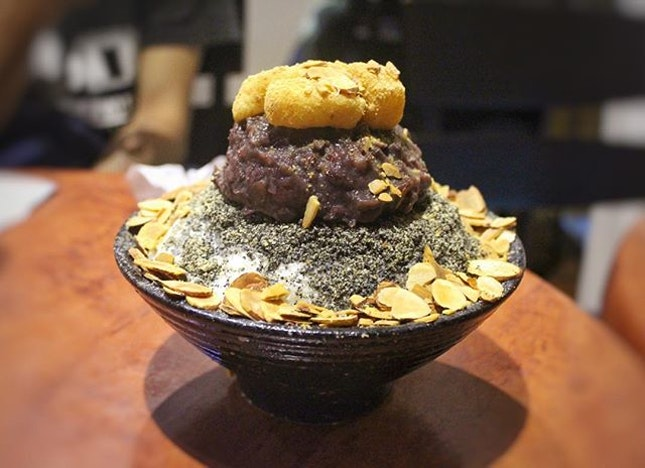 Black Sesame Bingsu -   Shaved ice topped with black sesame, almond flakes and a big scoop of redbean.