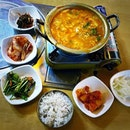 Sundubu jjigae to refuel before heading out for another long walk .