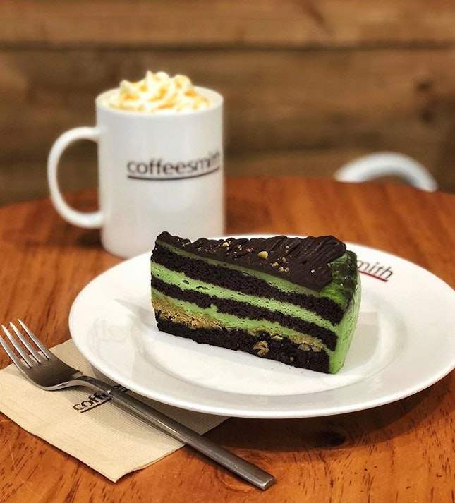 A cuppa cafe caramel vienna and pistachio chocolate cake - the much needed sweet indulgence for the ailing body🤒