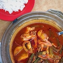 [JB] Asam Pedas with tender, meaty chunks of fish simmered in a spicy soup-like gravy, just sour enough to whet your appetite.
