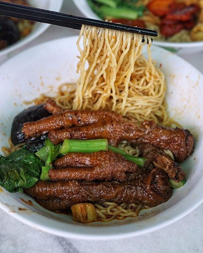 Signature chicken feet noodle.