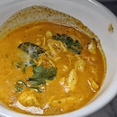 Succulent Crab Swimming In Curry