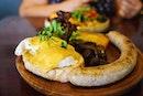 The Tuckshop Breakfast Combo #1 | Poached eggs, mushrooms, jumbo pork sausage, hash brown, dou ban jiang hollandaise, artisanal toast