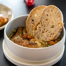 Summer Chicken Stew | slow-roasted chicken thigh, roasted potatoes and carrots, sundried tomato cream broth, sourdough