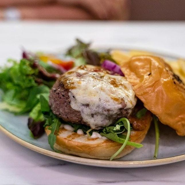 Wagyu Beef Cheese Burger | cheesy wagyu patty, arugula, onions, tomatoes, gherkins, fries