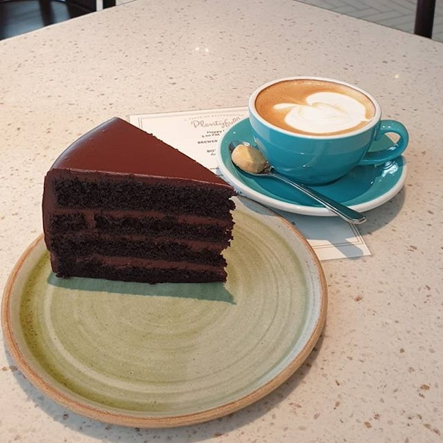 Perfect afternoon made with this luscious Devil's Food Cake and smooth creamy latte from Plentyfull.