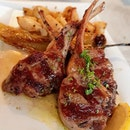 1: Lamb rack with roast potatoes  2: Hummus with pita bread  3: Greek salad with feta cheese  4: Beef and lamb meatballs  5: Grilled corn with spicy mayo  6: Souvlaki wrap with fries  7: Fried halloumi cheese and grilled octopus  8: Me (inedible)  This Greek restaurant in Dempsey Hill has a great ambience.