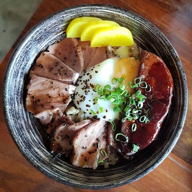 Foie Gras Truffle Yakiniku (SGD $23)  Pan-seared foie gras, US black angus short rib, onsen egg, truffle soy, black garlic brown butter over Tanuki Raw's signature rice.