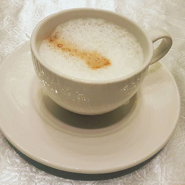 A lonely looking cuppa cappuccino