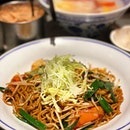Xin Wang signature XO Fried Noodles, with their iced milk tea...