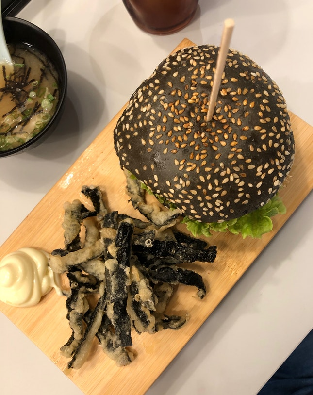 Salmon Mentaiko Charcoal Burger With Fried Fish Skins
